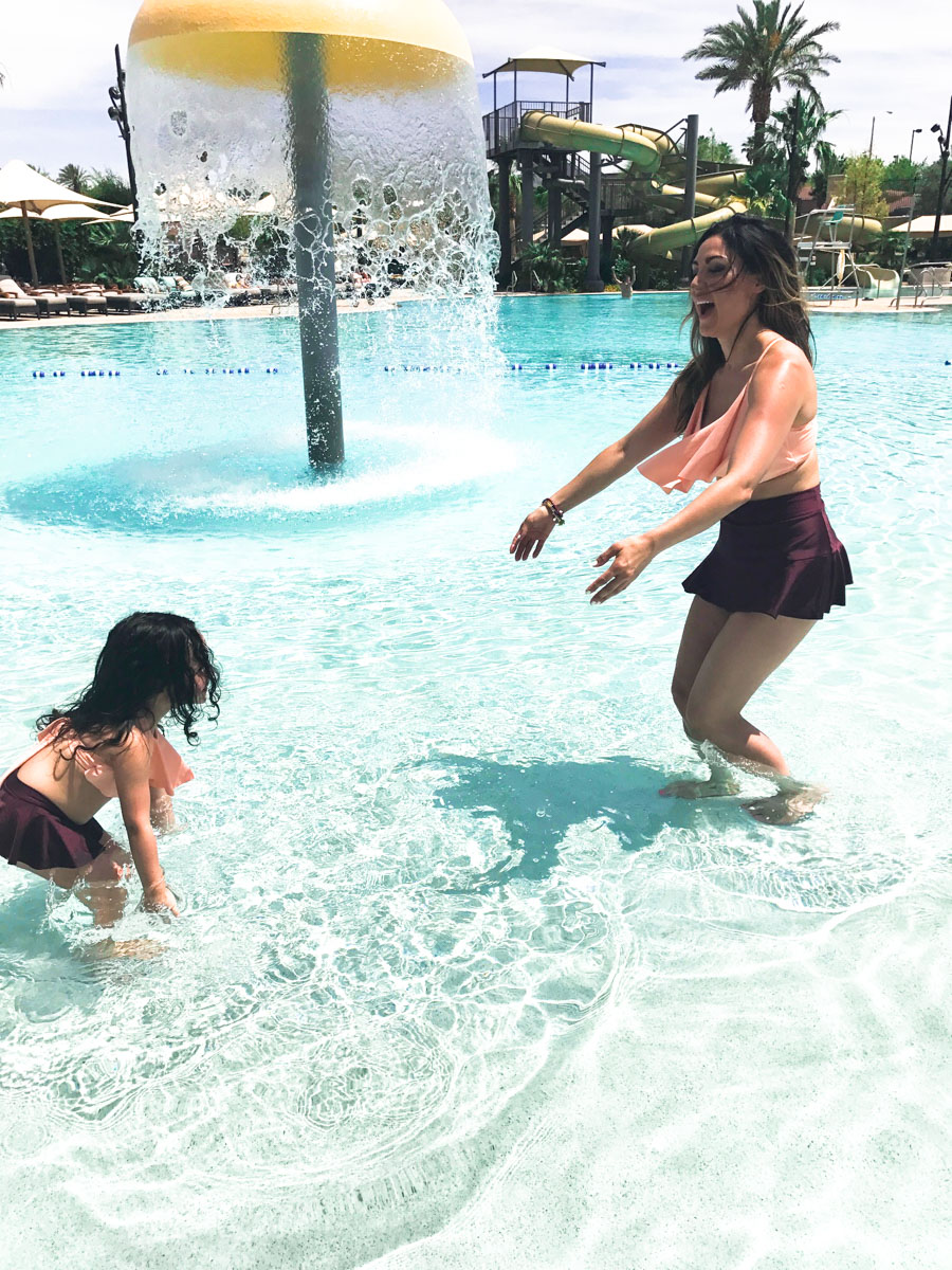 Mabel Montalva and daughter Karla swimming in the pool